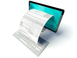desktop-computer-screen-with-tax-form-or-invoice